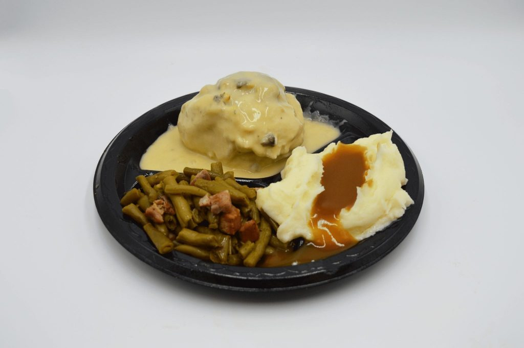 plates with green beans and mashed potatoes and gravy
