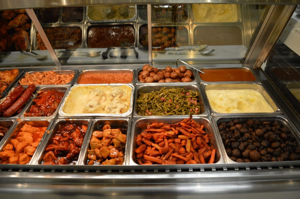 variety of BBQ meats and sides