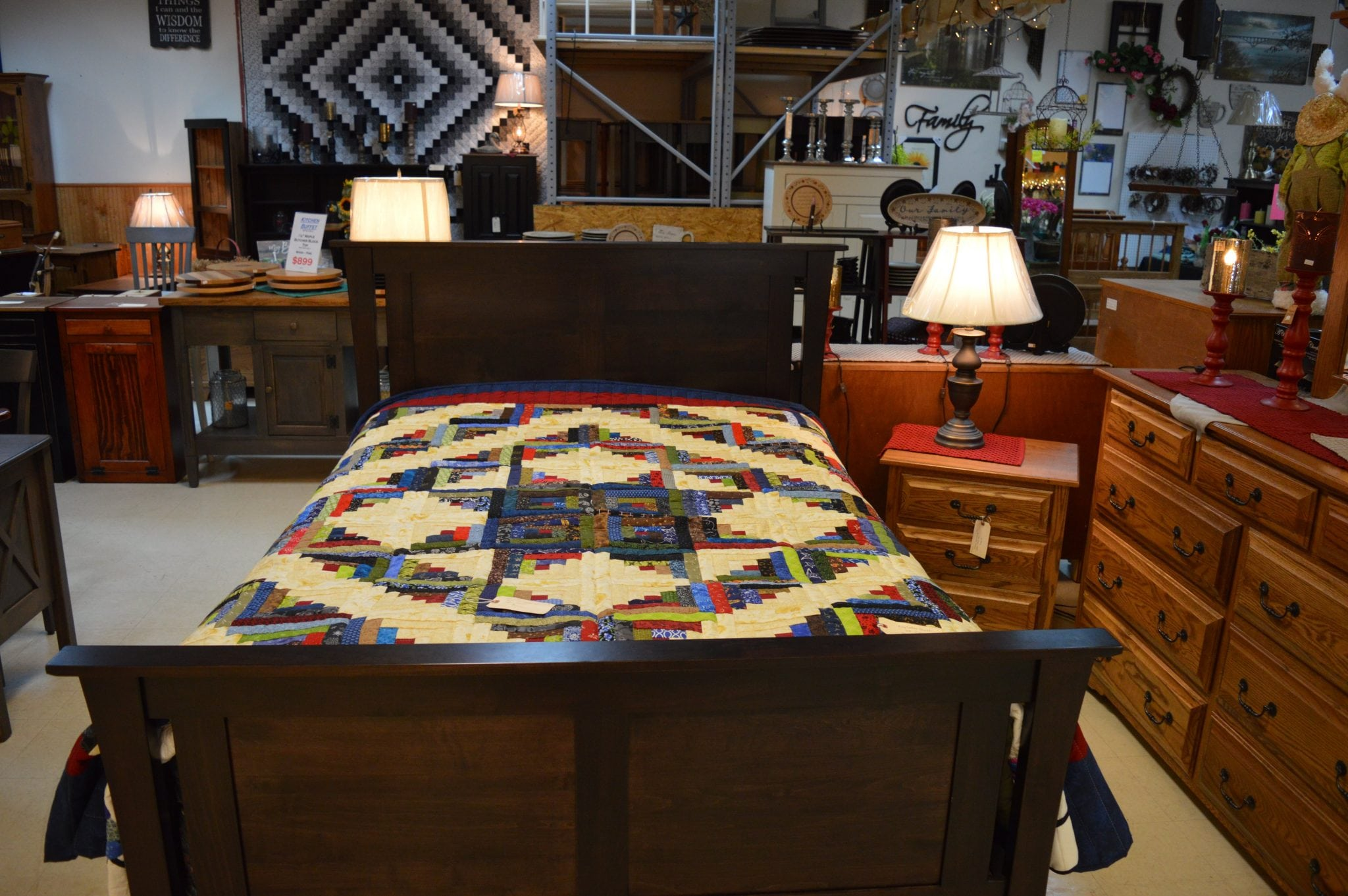 wooden bed with quilt