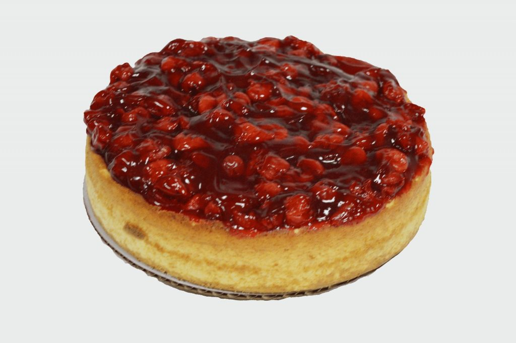 caked topped with strawberry sauce