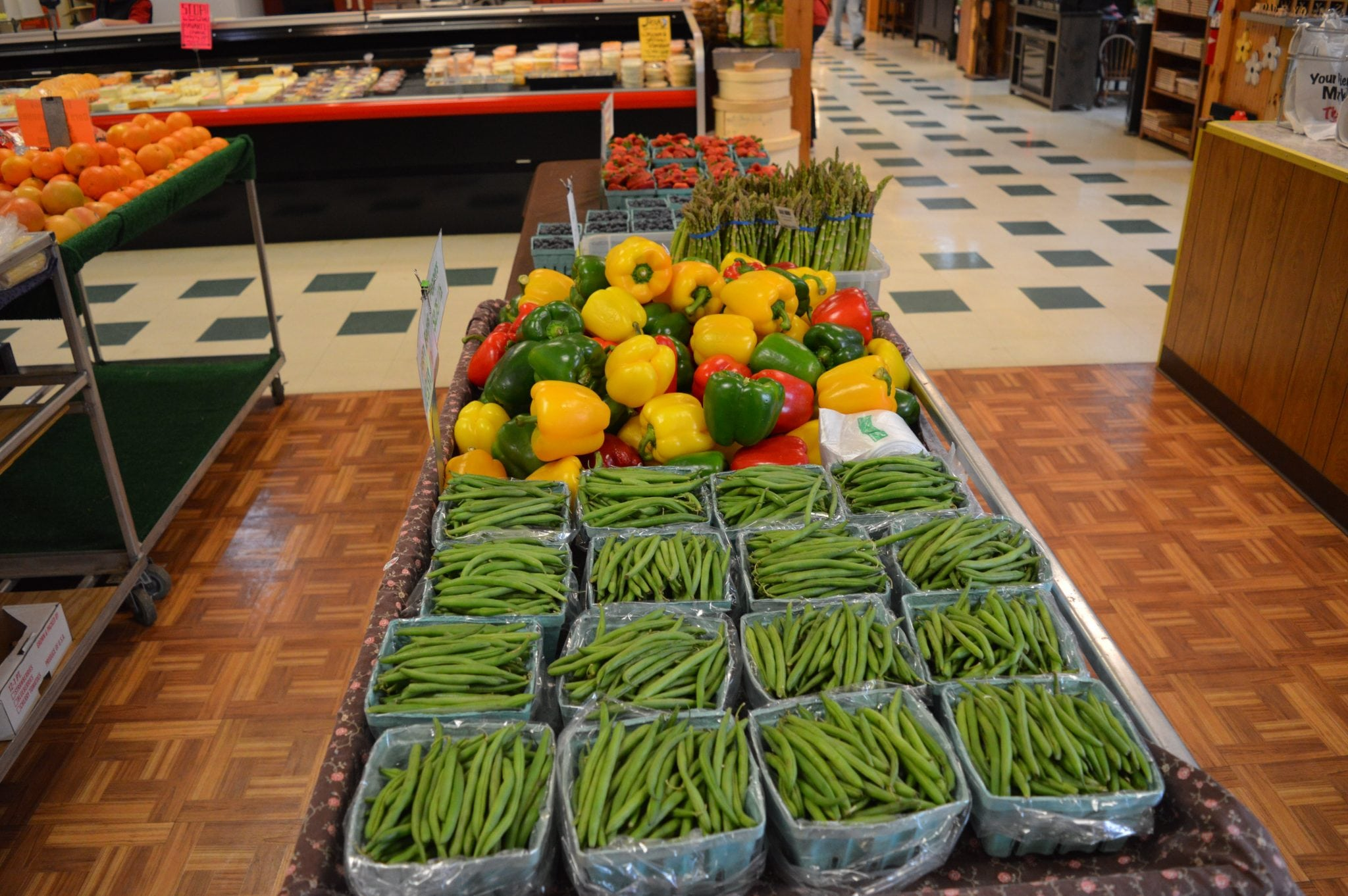 fresh produce including green beans and bell peppers