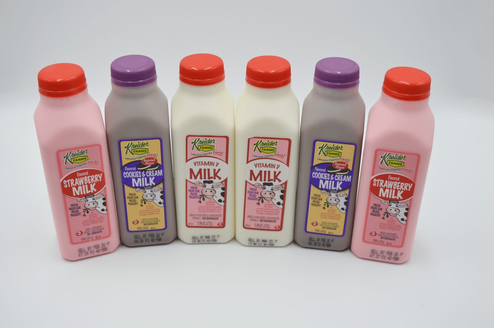 containers of milk, strawberry milk, and cookies & cream milk