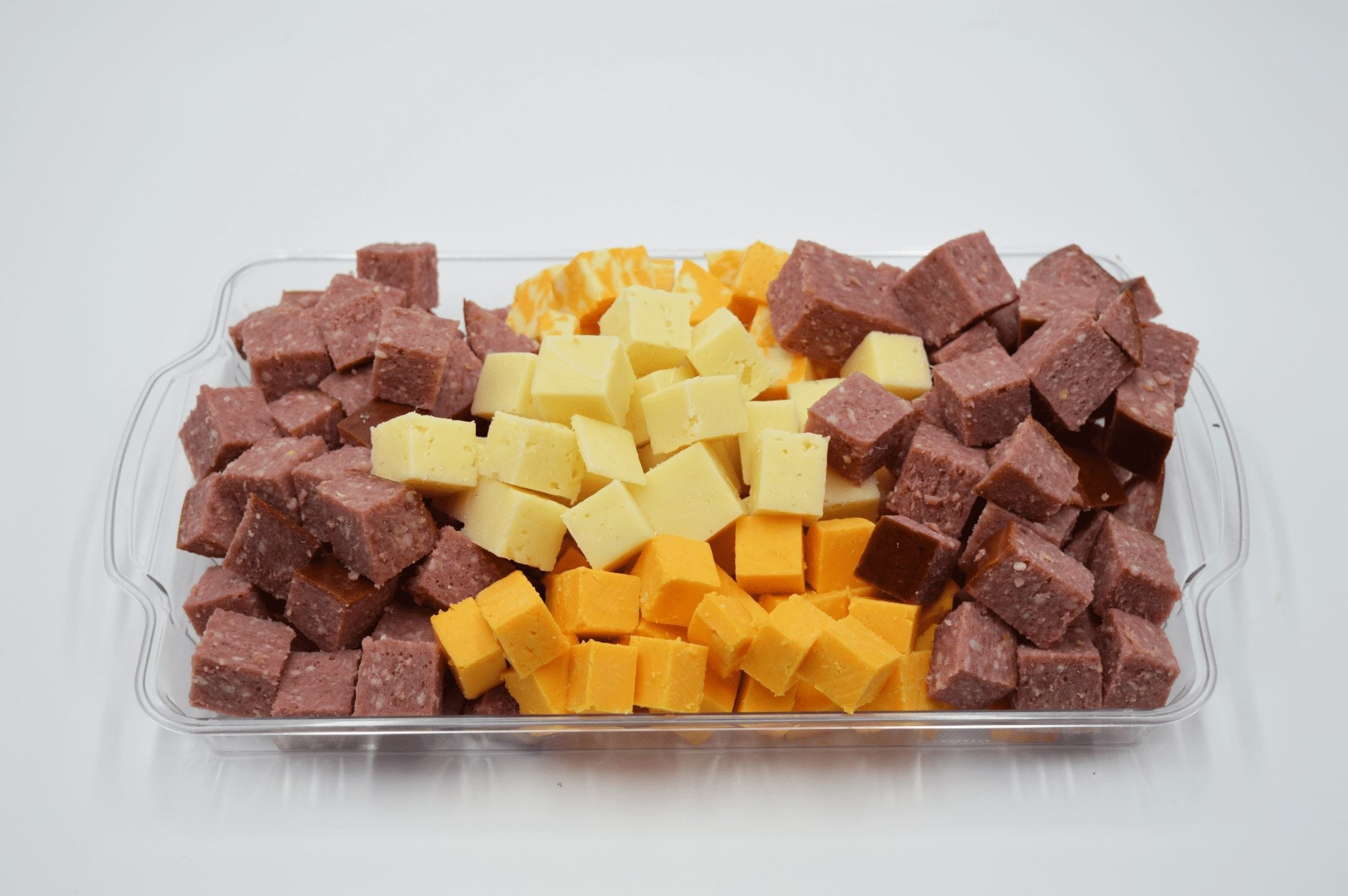 platter of cured meat and cheese cubes