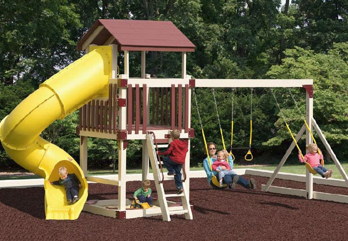 child's playset with swings and curly slide
