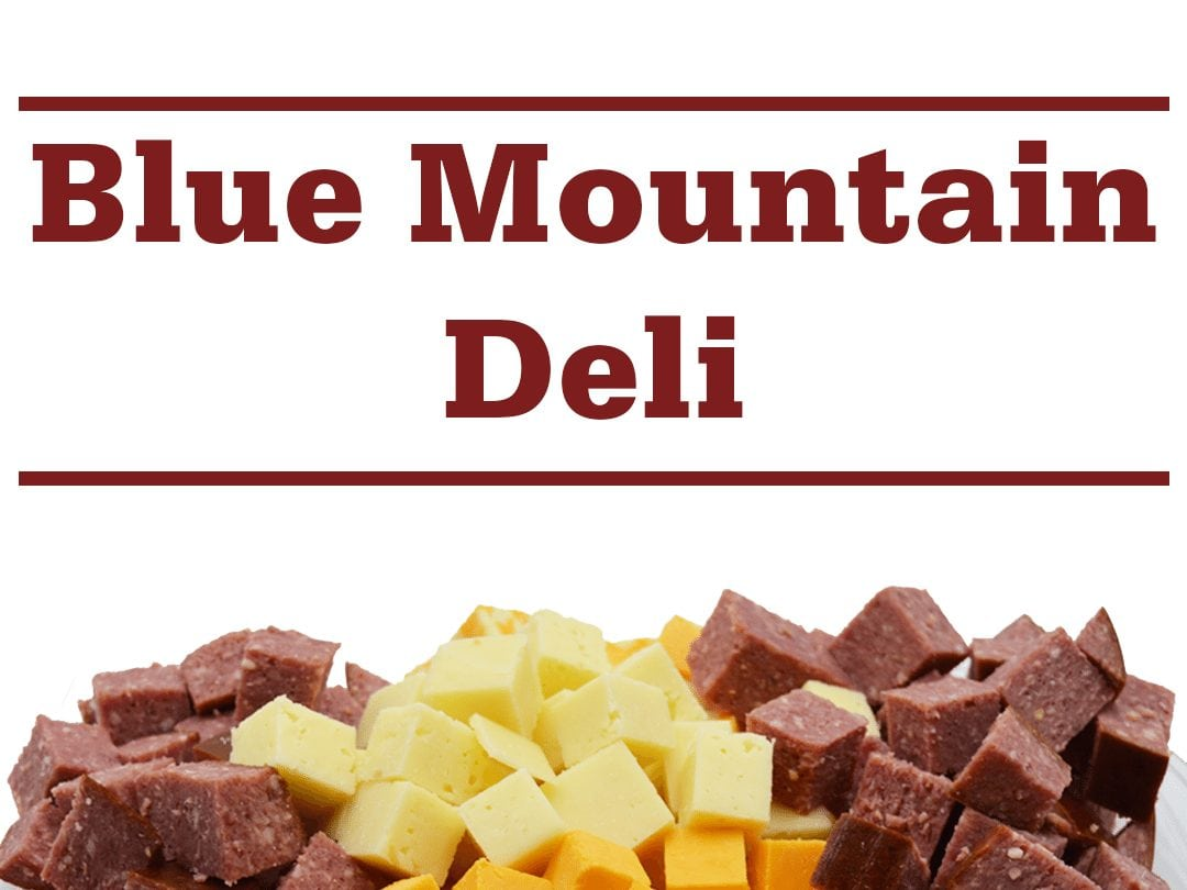 "a selection of cured meat and cheese cubes AND words ""Blue Mountain Deli"""
