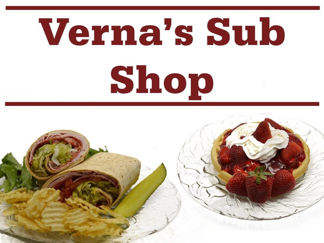 "wrap with chips and pickle spear, waffle topped with strawberries and whipped cream, and words ""Verna's Sub Shop"""
